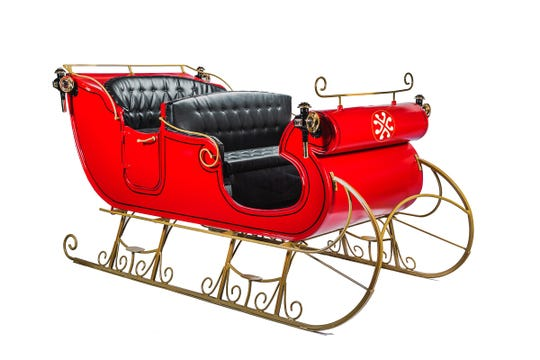 At the Magical Virtual Sleigh Ride at Water Tower Place in Chicago, families can get in a real sleigh to take a virtual ride.