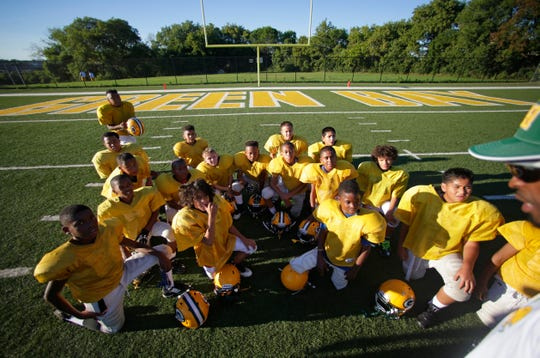 The Journey House Packers youth football program plays on a replica Lambeau Field donated by the Green Bay Packers.