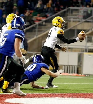 Racine St. Catherine's   Da'Shaun Brown scrambles for the 2 point conversion after the touchdown to take the lead during the Racine Saint Catherine 8-7 win over Saint Croix Central in the Division 4 2018 Football State Championship at Camp Randall in Madison, Wisconsin, Thursday, November 15, 2018. RICK WOOD/MILWAUKEE JOURNAL SENTINEL