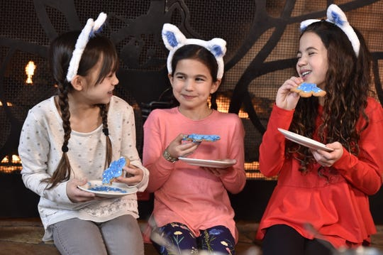 During Great Wolf Lodge's Snowland Extravaganza, kids can decorate cookies in a lifesize gingerbread house.