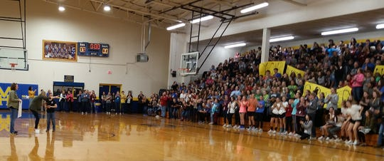 Dyson  learns his Make-a-Wish request has been granted as students cheer at Mountain Home Junior High.