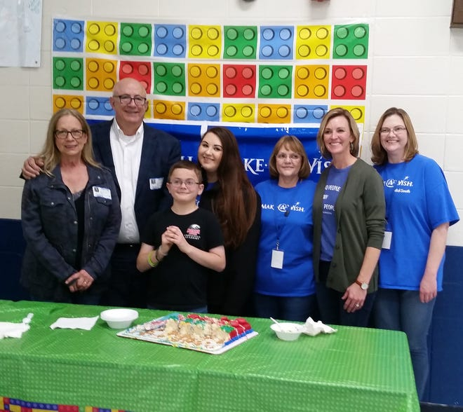Dyson (front, center) is joined by (from left) Mary and Larry McGrath, Paige Vickery, Phyllis Vickery, Cara Coleman and Debbie Bales at a Make-a-Wish ceremony at Mountain Home Junior High School.