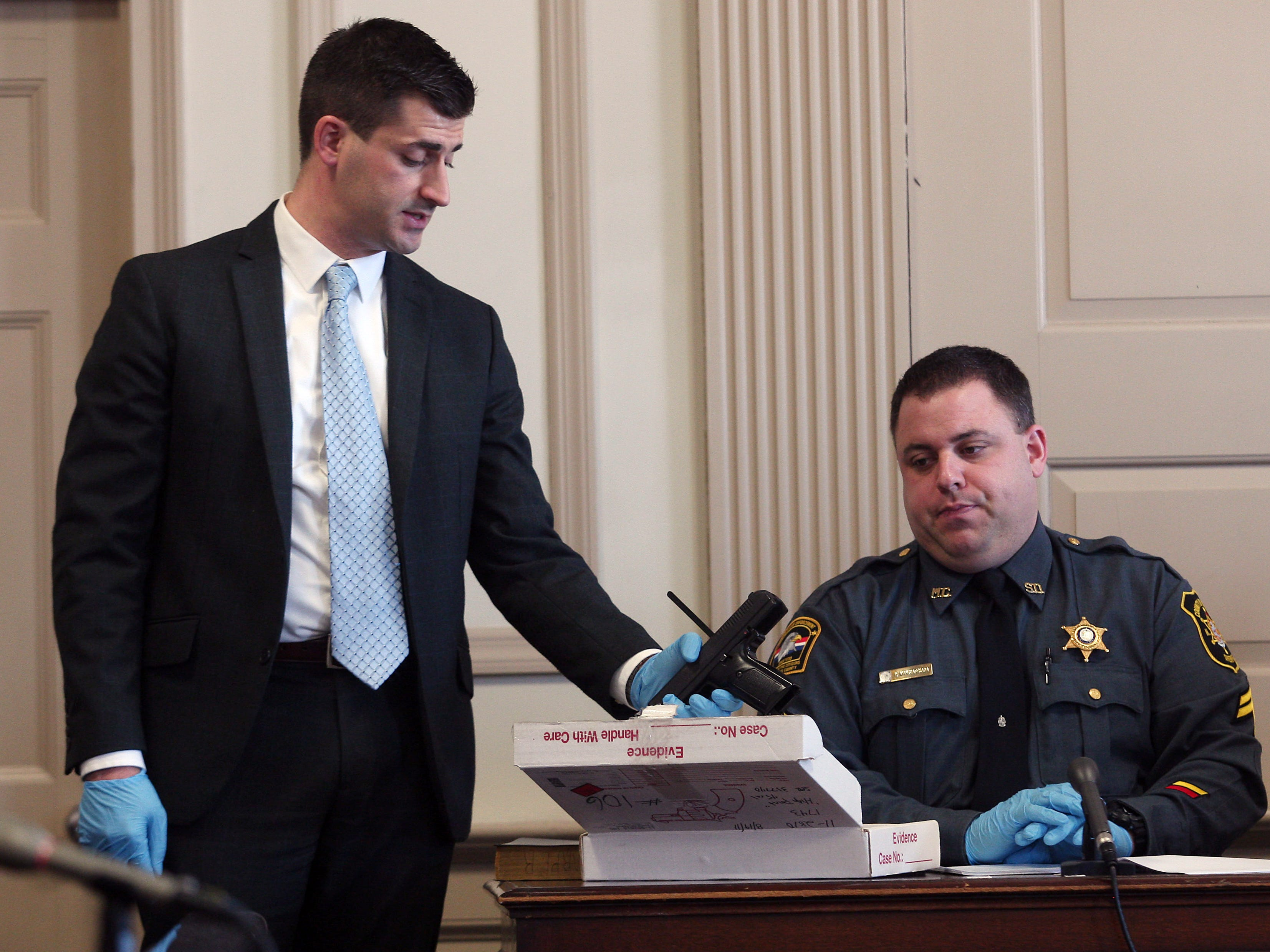 Assistant Prosecutor Matthew Troiano shows one of three guns found at the residence of Antionette Stephen for identification by Morris County Sheriff Detective Phil Mangiafridda during direct testimony. Stephen pleaded guilty to murder last year and is expected to testify against Kashif Parvaiz in his murder trial, accused of killing his wife Nazish Noorani in August 2011.  February 11, 2015. Morristown, N.J. Bob Karp/Staff Photographer.
