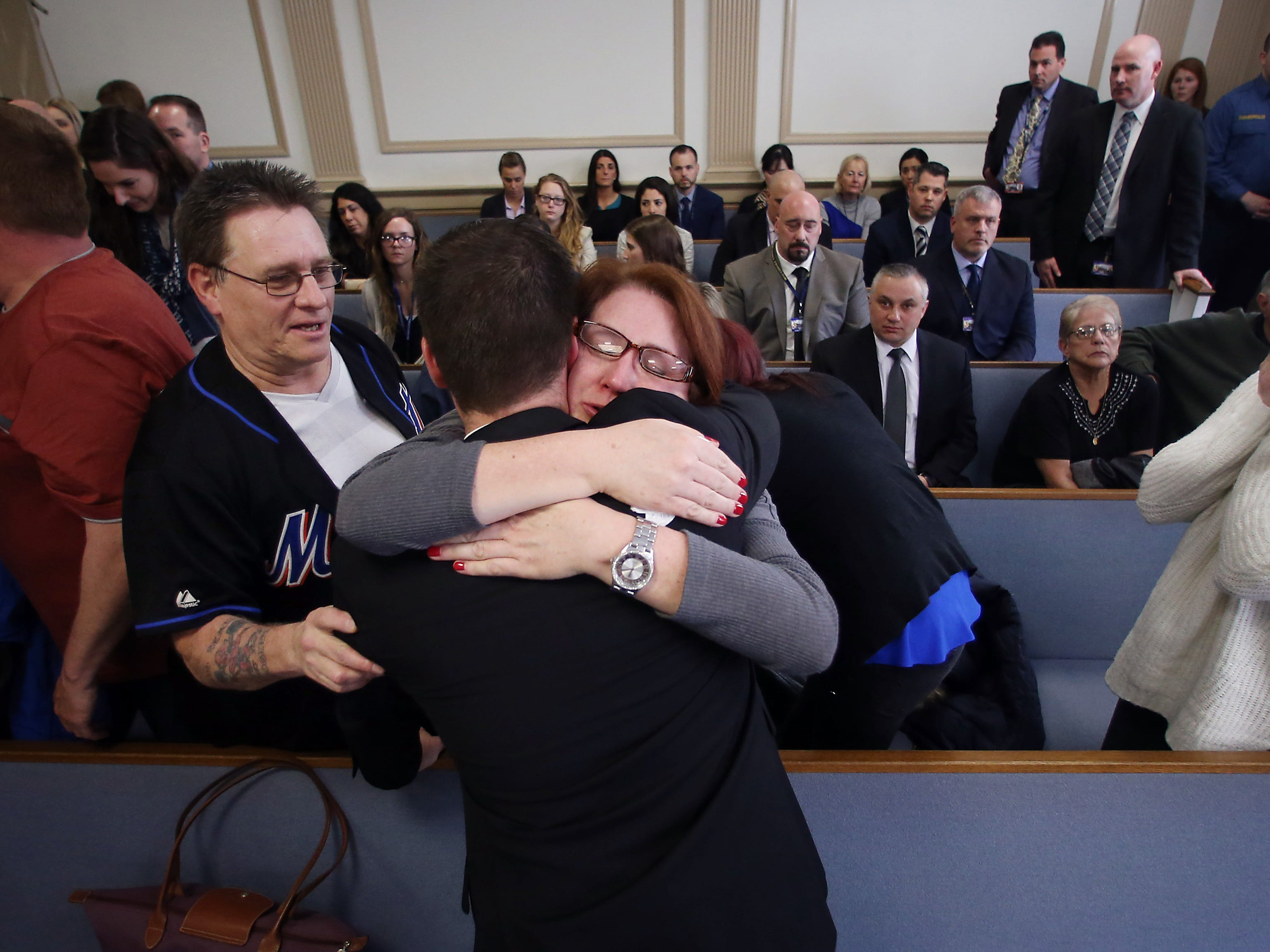 Teresa Higgins, former wife of victim Patrick Gilhuley gives a hug to Assistant Prosecutor Matthew Troiano after a jury deliberating over two days found Virginia Vertetis guilty of murder in Morris County Superior Court Monday. Prosecutors contended that Vertetis purposely shot Gilhuley at her Mount Olive home in 2014 out of desperation that he was breaking up with her. April 3, 2017, Morristown, NJ