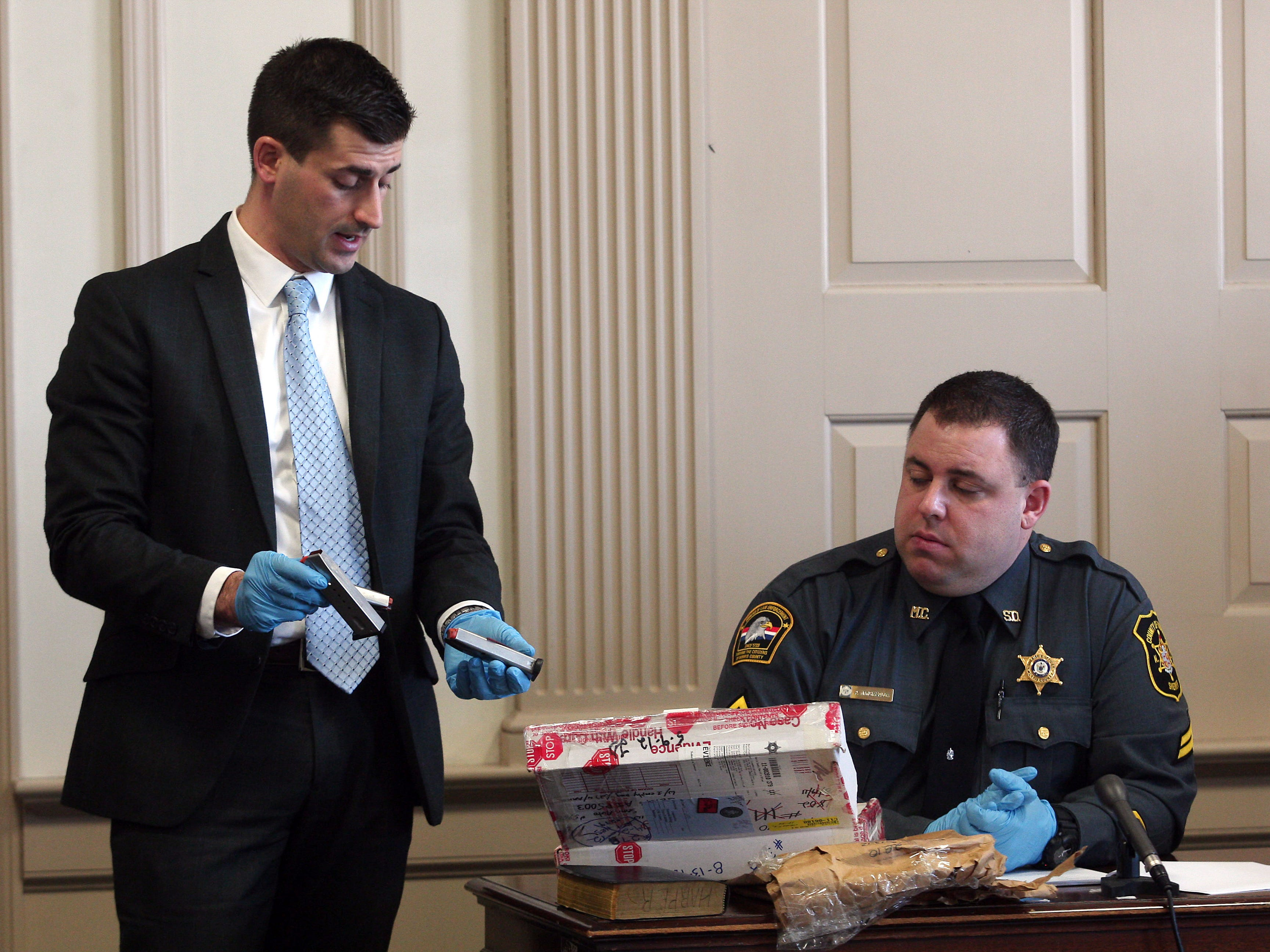 Assistant Prosecutor Matthew Troiano shows magazines found at the residence of Antionette Stephen for identification by Morris County Sheriff Detective Phil Mangiafridda during direct testimony. Stephen pleaded guilty to murder last year and is expected to testify against Kashif Parvaiz in his murder trial, accused of killing his wife Nazish Noorani in August 2011.  February 11, 2015. Morristown, N.J. Bob Karp/Staff Photographer.