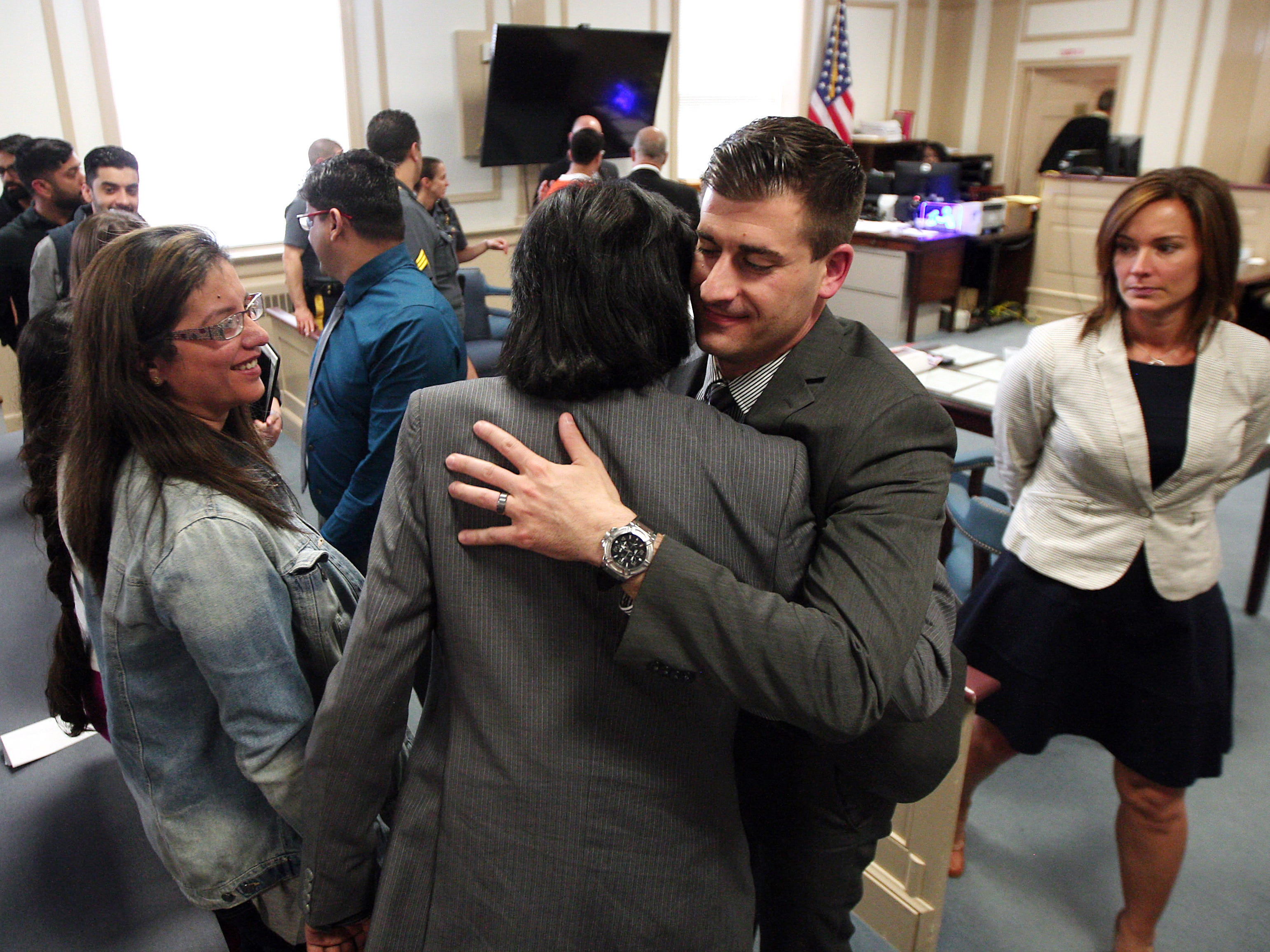 Assistant Prosecutor Matthew Troiano hugs the family of Nazish Noorani as Morris County Assistant Prosecutor Erin Callahan looks on after Kashif Parvaiz was sentenced to life in state prison, plus 10 years, in the murder of his wife who was shot to death on a Boonton street by Antionette Stephen in 2011. May 21, 2015. Morristown, N.J. Bob Karp/Staff Photographer.