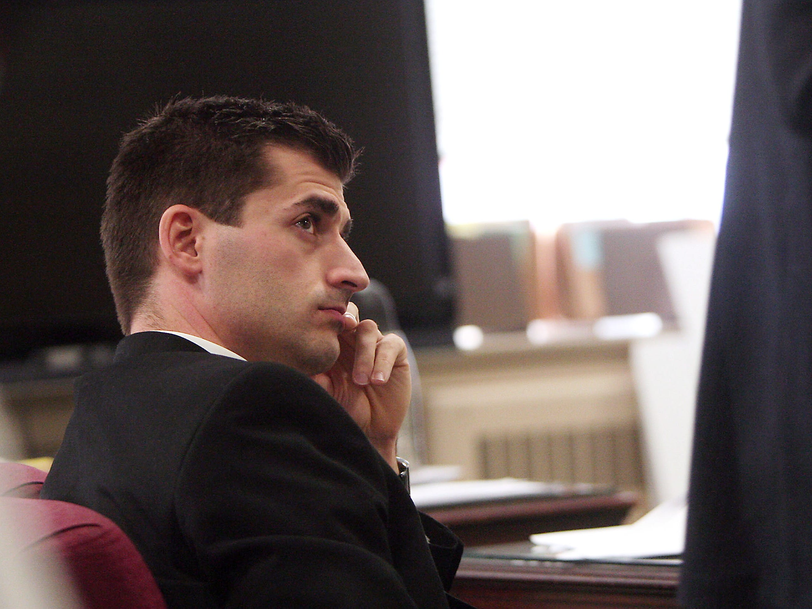 Morristown, N.J.- January 29, 2013---Assistant Morris County Prosecutor Matthew Troiano listens to the defenses closing summations in the murder trial of Amalia Mirasola charged with the shooting death of her husband in their Butler home in 2010. Mirasola, 47, is seriously debilitated today by multiple sclerosis, which was less severe at the time of the shooting. 