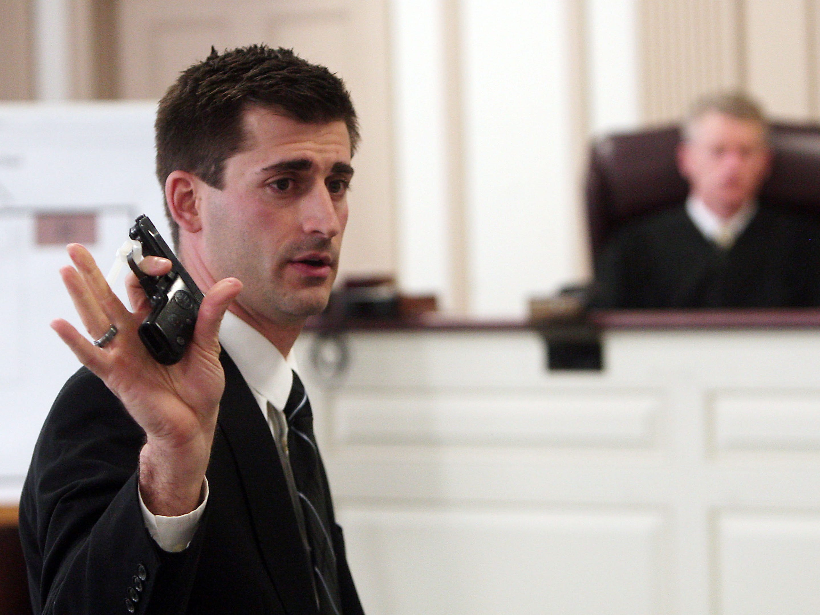 Morristown, N.J.- January 29, 2013--- Assistant Morris County Prosecutor Matthew Troiano holds a small caliber handgun found at the scene and put into evidence during closing summations in the murder trial of Amalia Mirasola charged with the shooting death of her husband in their Butler home in 2010. Mirasola, 47, is seriously debilitated today by multiple sclerosis, which was less severe at the time of the shooting. 