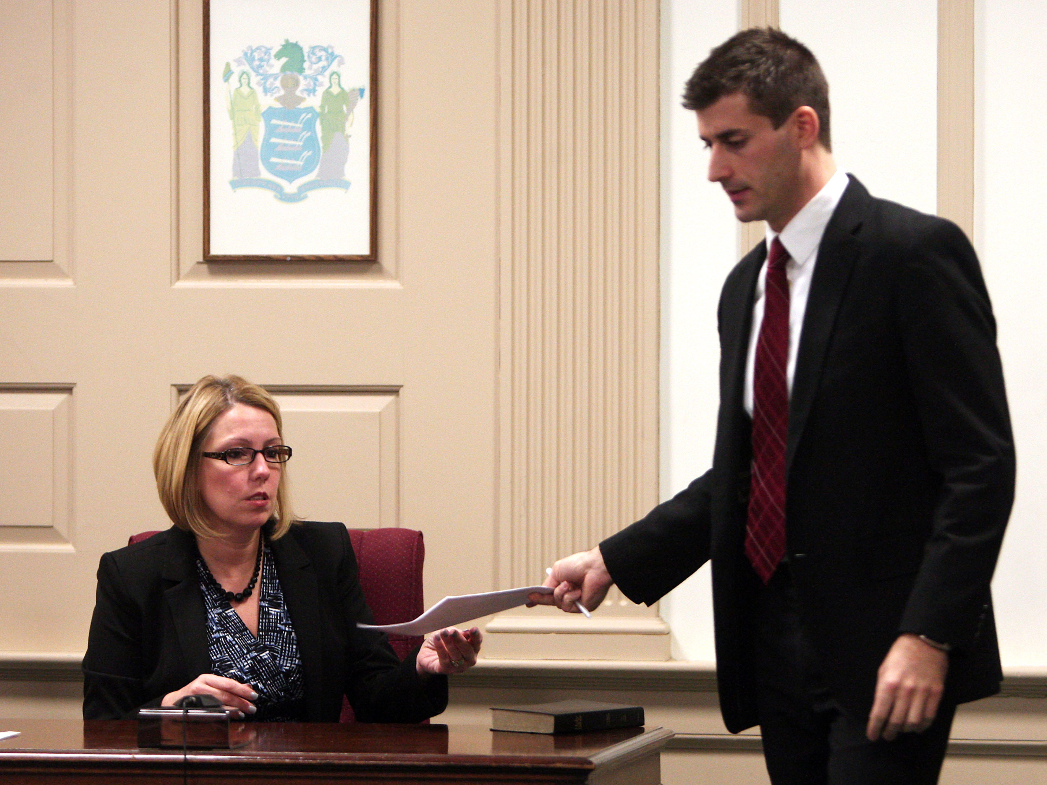 Morristown, N.J.- January 16, 2013---Butler Police Detective Colleen Pascale answers questions during direct examination from Morris County Assistant Prosecutor Matthew Troiano during the State vs. Amalia Mirasola on trial charged with the shooting death of her husband in their Butler home in 2010. Mirasola, 47, is seriously debilitated today by multiple sclerosis, which was less severe at the time of the shooting. 