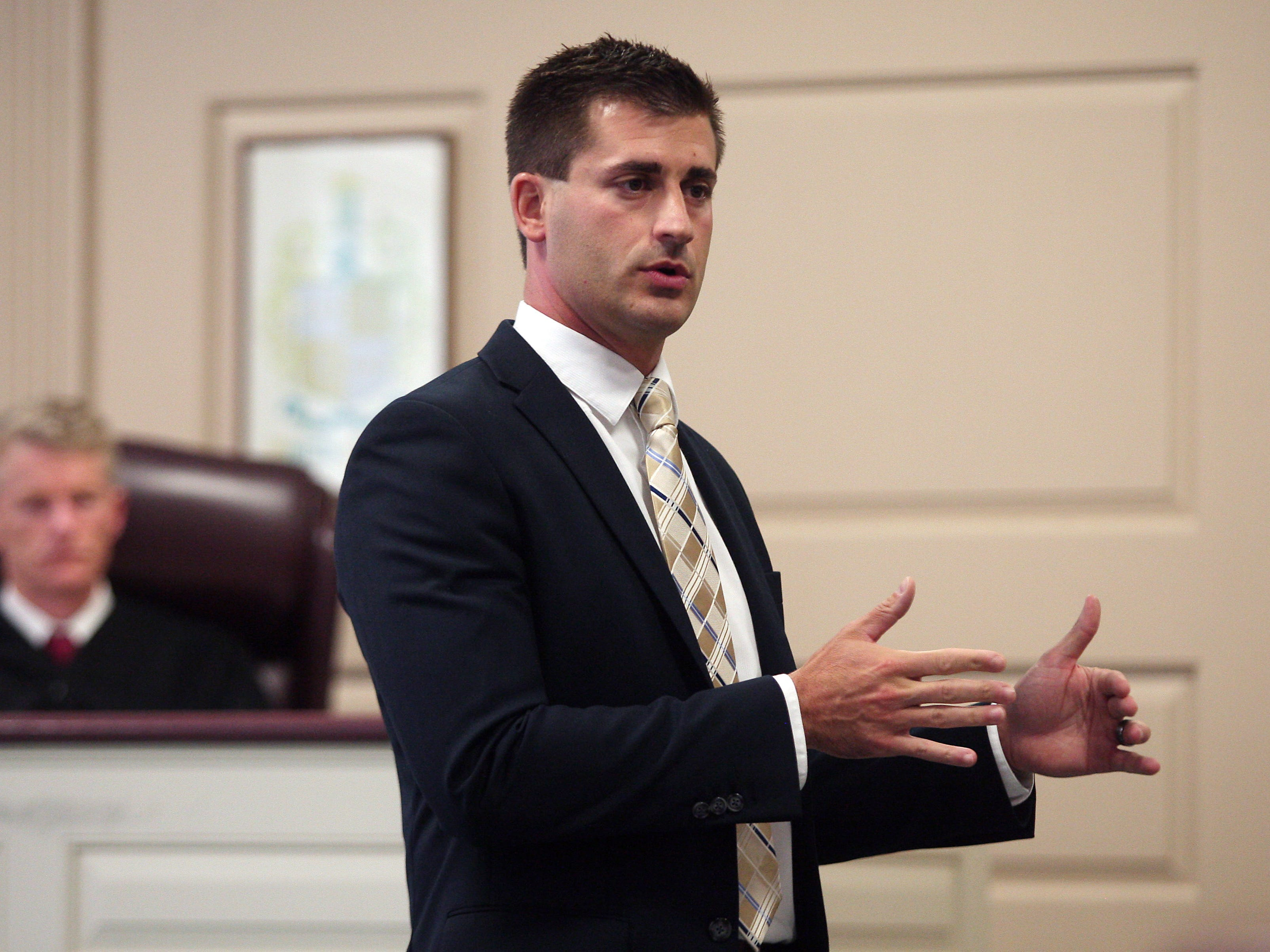 Morris County Assistant Prosecutor Matthew Troiano gives his opening statements in Morris County Superior Court during the Carlos Rojas murder trial, Rojas is charged with fatally beat Esteban Hernandez-Vazquez, 27, of North Bergen, on Aug. 3, 2011, in Fairview, Bergen County.  October 14, 2014, Morristown, NJ. Photo by Bob Karp