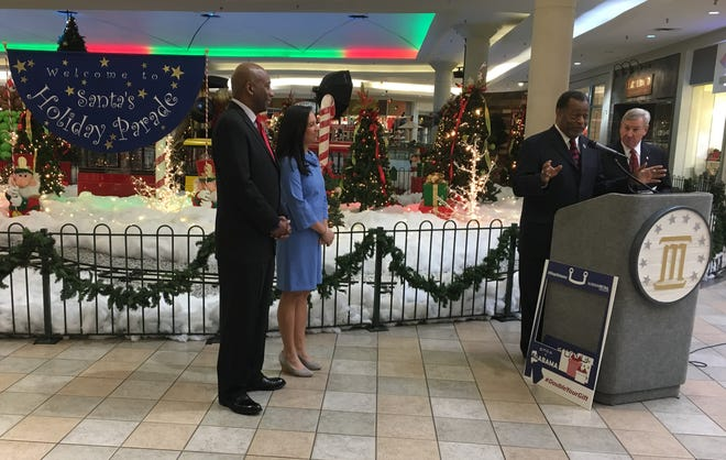 From left, state Secretary of Labor Fitzgerald Washington, Alabama Retail Association Communications Manager Melissa Warnke, Montgomery County Commission Chairman Elton Dean, and Montgomery Mayor Todd Strange speak during a holiday shopping kickoff event Thursday at Eastdale Mall.