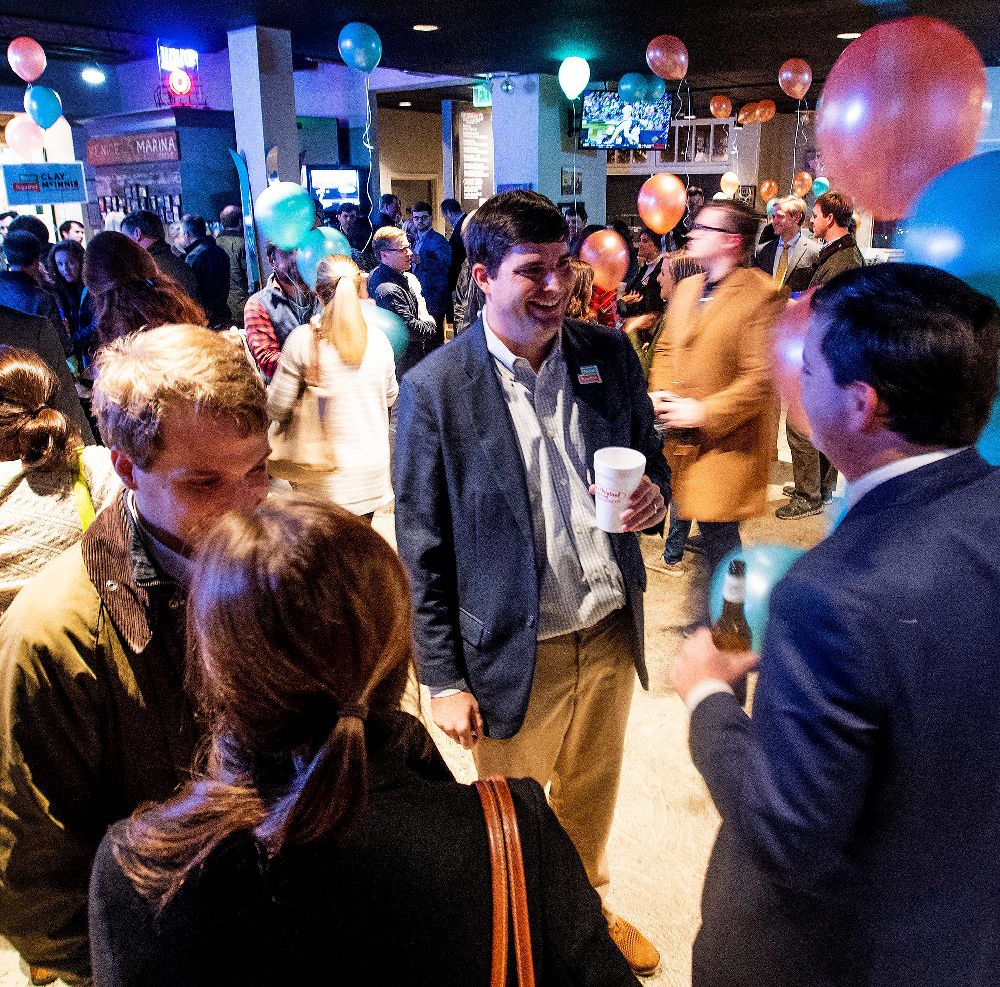 Clay McInnis talks with supporters at his city council campaign kickoff at Moe's BBQ in Montgomery, Ala., on Thursday evening November 15, 2018.