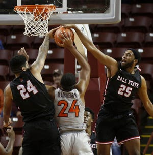 Virginia Tech's Kerry Blackshear, Jr., center, has his shot blocked against the defense of Ball State's Trey Moses, eft, and Tahjai Teague during the second half of an NCAA college basketball game at the Charleston Classic at TD Arena, Thursday, Nov. 15, 2018, in Charleston, S.C. Virginia Tech won 76-64. (AP Photo/Mic Smith)