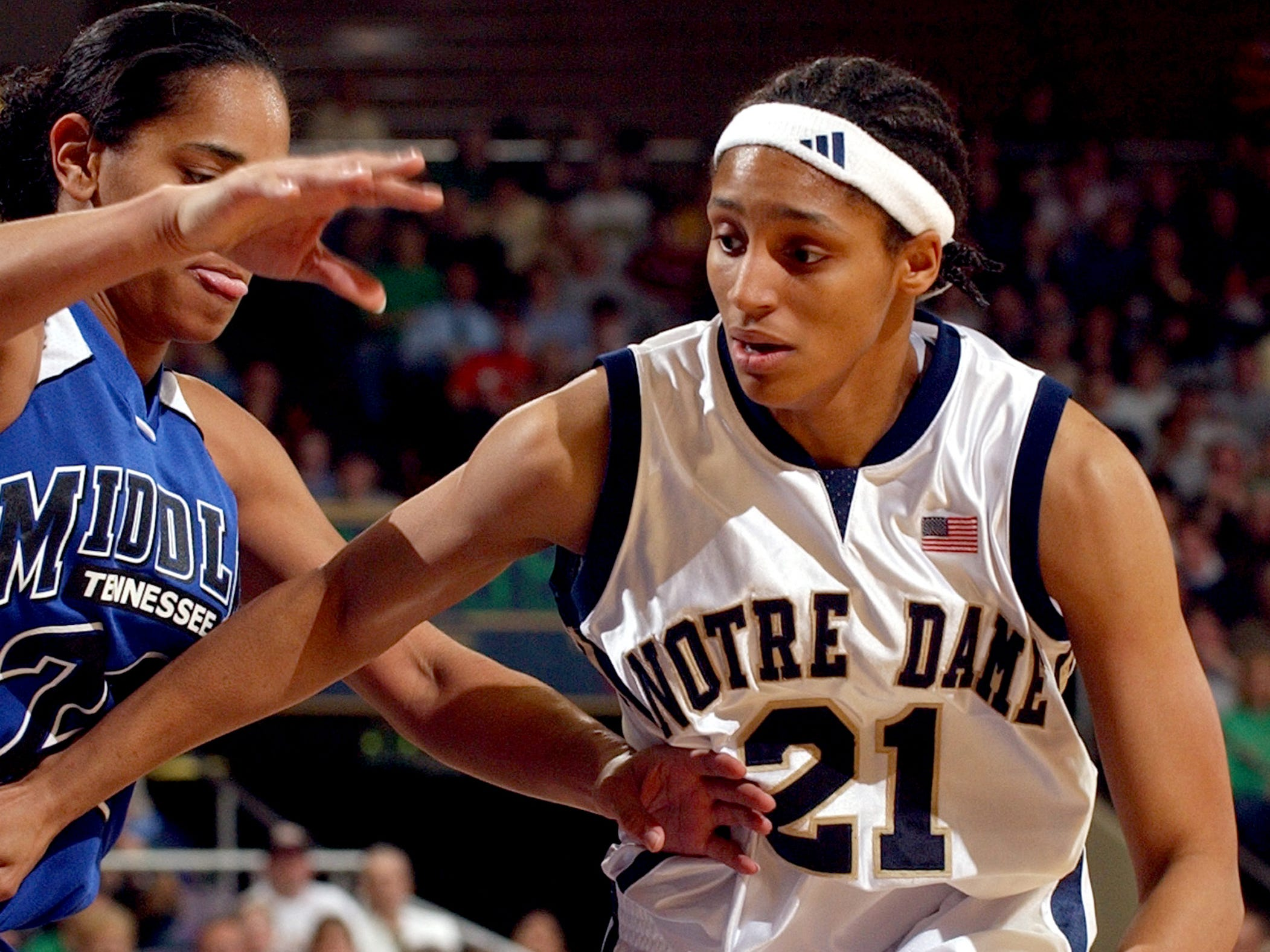 Notre Dame guard Jacqueline Batteast attempts to drive the lane against Middle Tennessee State guard Tia Stovall during the first half of a second round NCAA East game Tuesday March 23 2004 in South Bend Ind.