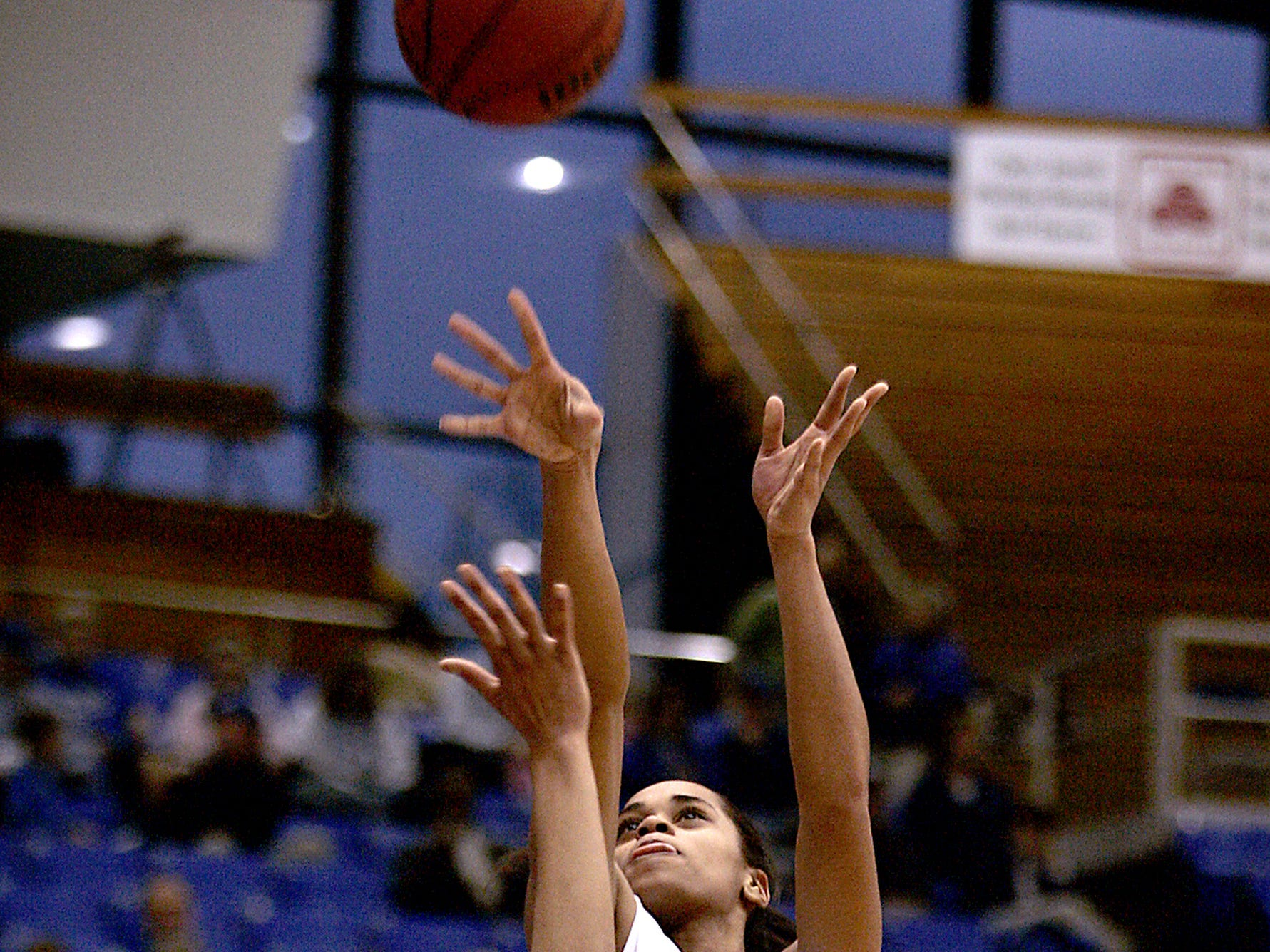 MTSU foward Tia Stovall lets a shot off during the game against Denver University at the Murphy Center Saturday.