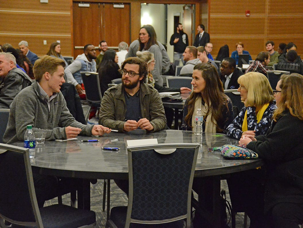 Friends and family gathered with students and faculty at MTSU Thursday night to remember Angie Walker, a university professor who lost her life in a tornado that ripped through Rutherford County Nov. 6, 2018. Student Wesley Johnson, far left, talks with Dylan Reed, Angie's cousin Alyssa Leahey, her mother-in-law LeeAnn Walker, and sister-in-law Kristin Carlton.