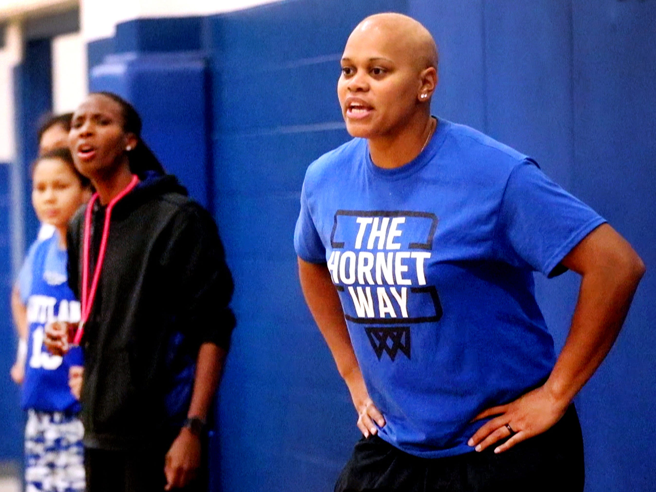 Huntland middle school girls basketball coach Tia Stovall gives instruction from the sidelines as her assistant coach and spouse Santana Seay also gives out instructions in the background, on Tuesday, Nov. 13, 2018.