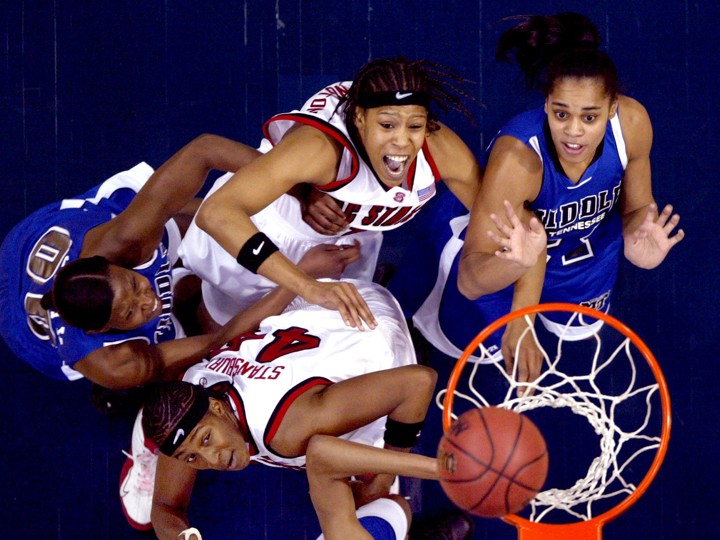 North Carolina State center Tiffany Stansbury (44) and teammate Khadijah Whittington (1) wait for the rebound with Middle Tennessee players Clara Gray (00) and Tia Stovall (21) during the first half of their NCAA tournament first-round game in Dallas, Saturday, March 19, 2005.