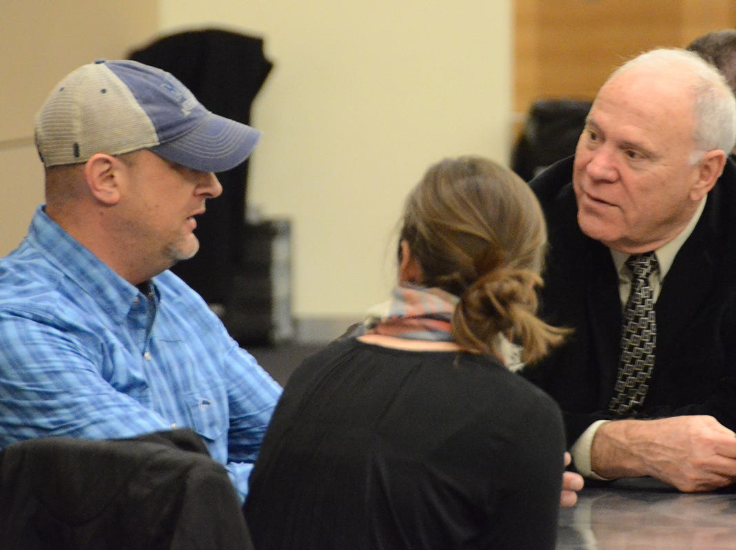 Scott Walker, husband of Angie Walker, an MTSU professor who died in a tornado Nov. 6, 2018, talks with members of a group that gathered at the university Thursday night to remember his wife.