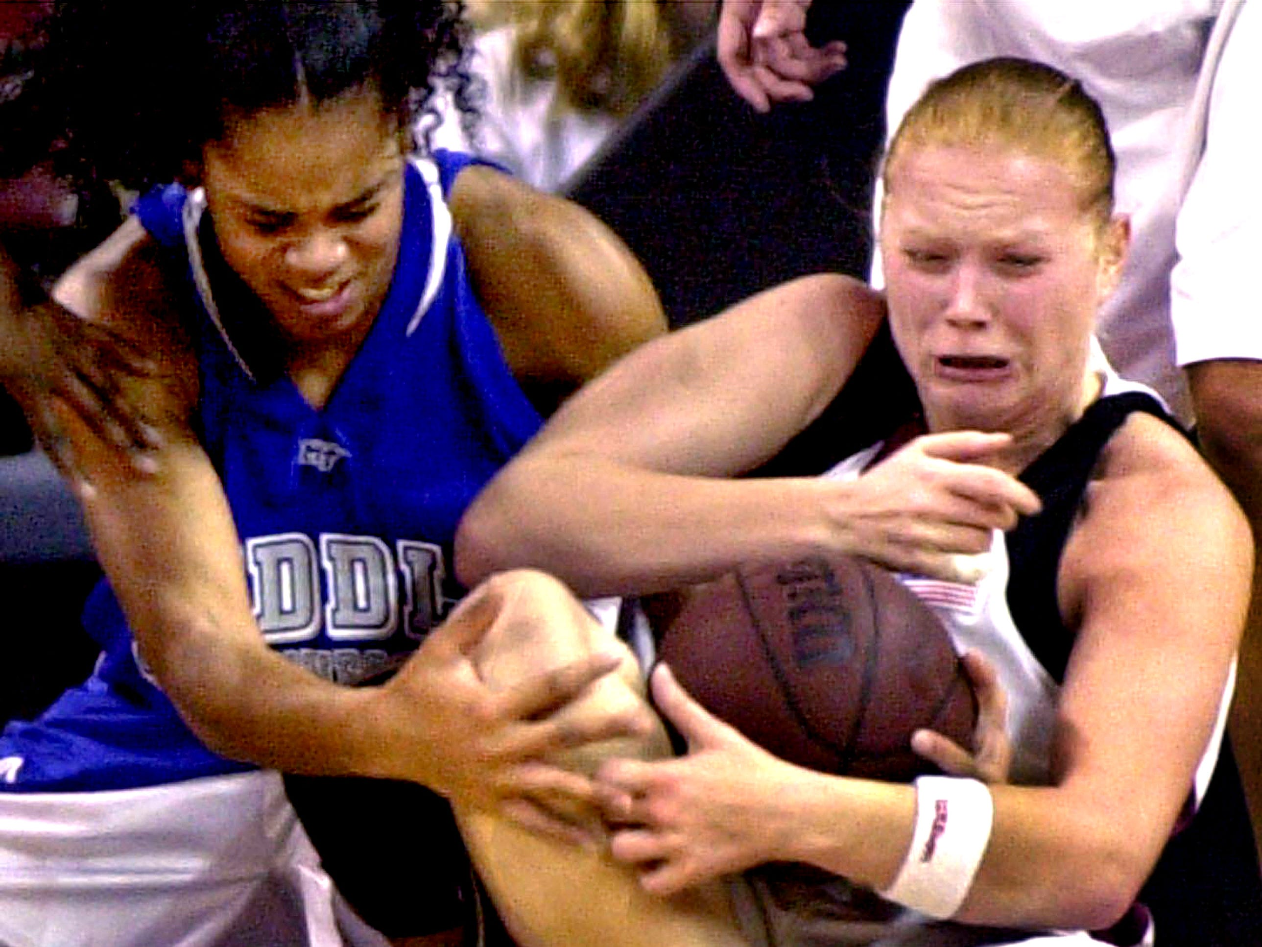 Middle Tennessee's Tia Stovall, left, and South Carolina's Cristina Ciocan battle for control of the ball Monday night, Dec. 16, 2002,  at the Carolina Center in Columbia, S.C.
