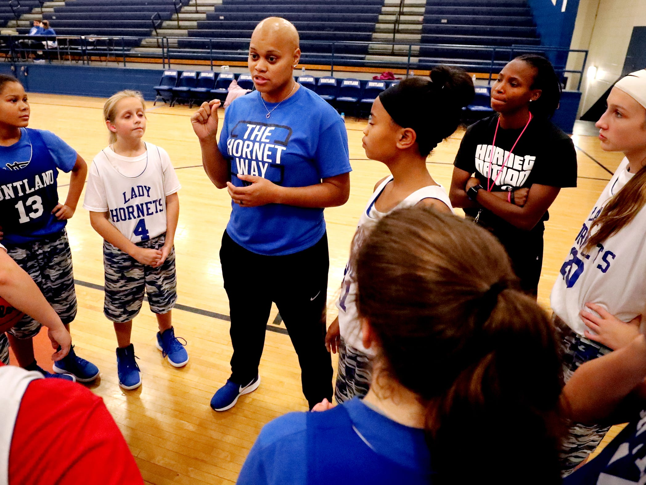 Huntland middle school girls basketball coach Tia Stovall talks with her team during a huddle near the end of practice on Tuesday, Nov. 13, 2018.