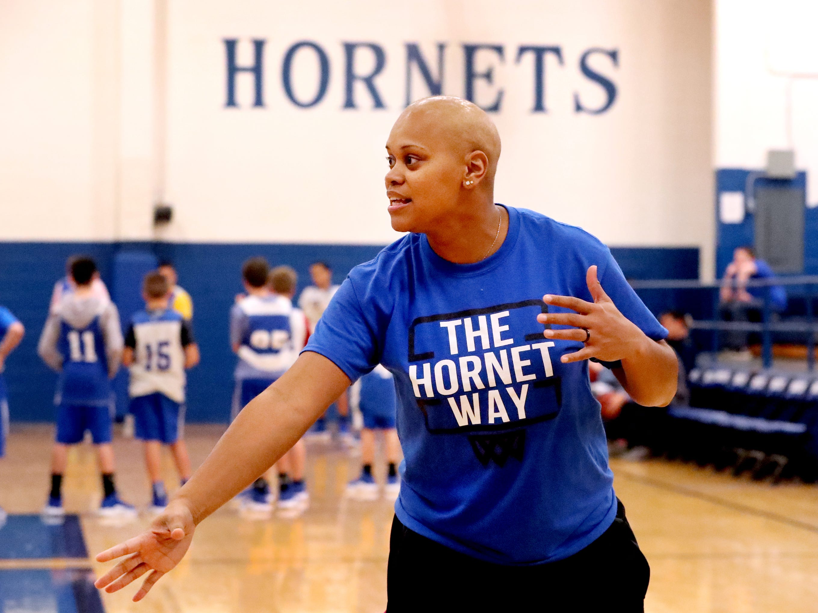 Coach Tia Stovall goes over how to run a drill during her team's middle school girls practice on Tuesday, Nov. 13, 2018.