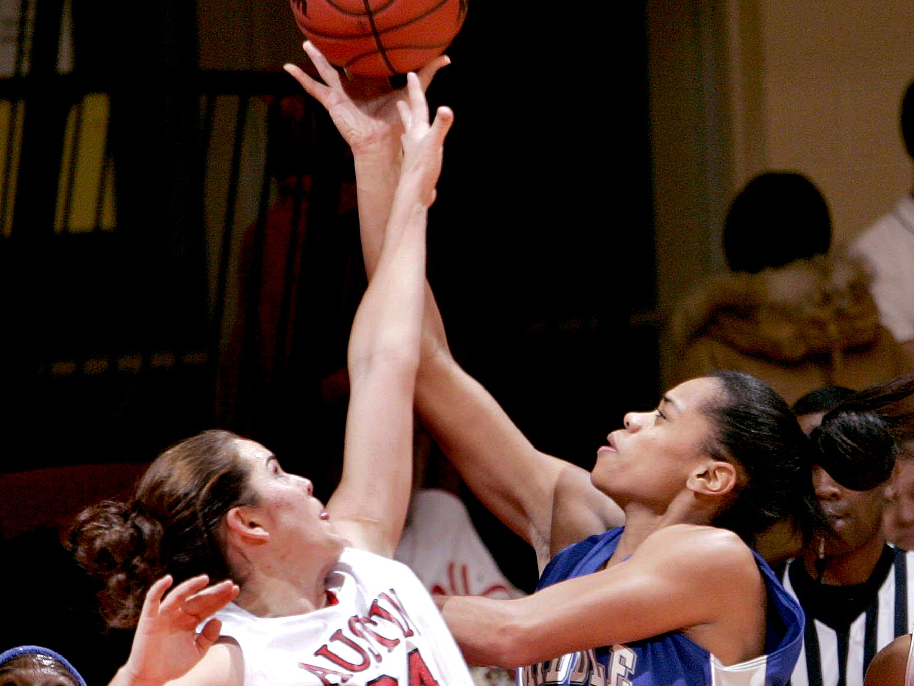 Middle Tennessee's Tia Stovall drives around Austin Peay's Breana Link during the first half of Wednesday night's game at the Dunn Center. The Lady Govs won 71-69.