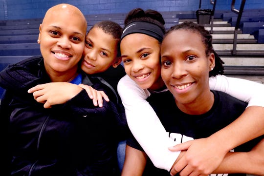 (L to R) Huntland middle school basketball coach Tia Stovall, with her family the twins Tyrese Stovall, TaTianna Stovall and spouse Santana Seay, on Tuesday, Nov. 13, 2018.