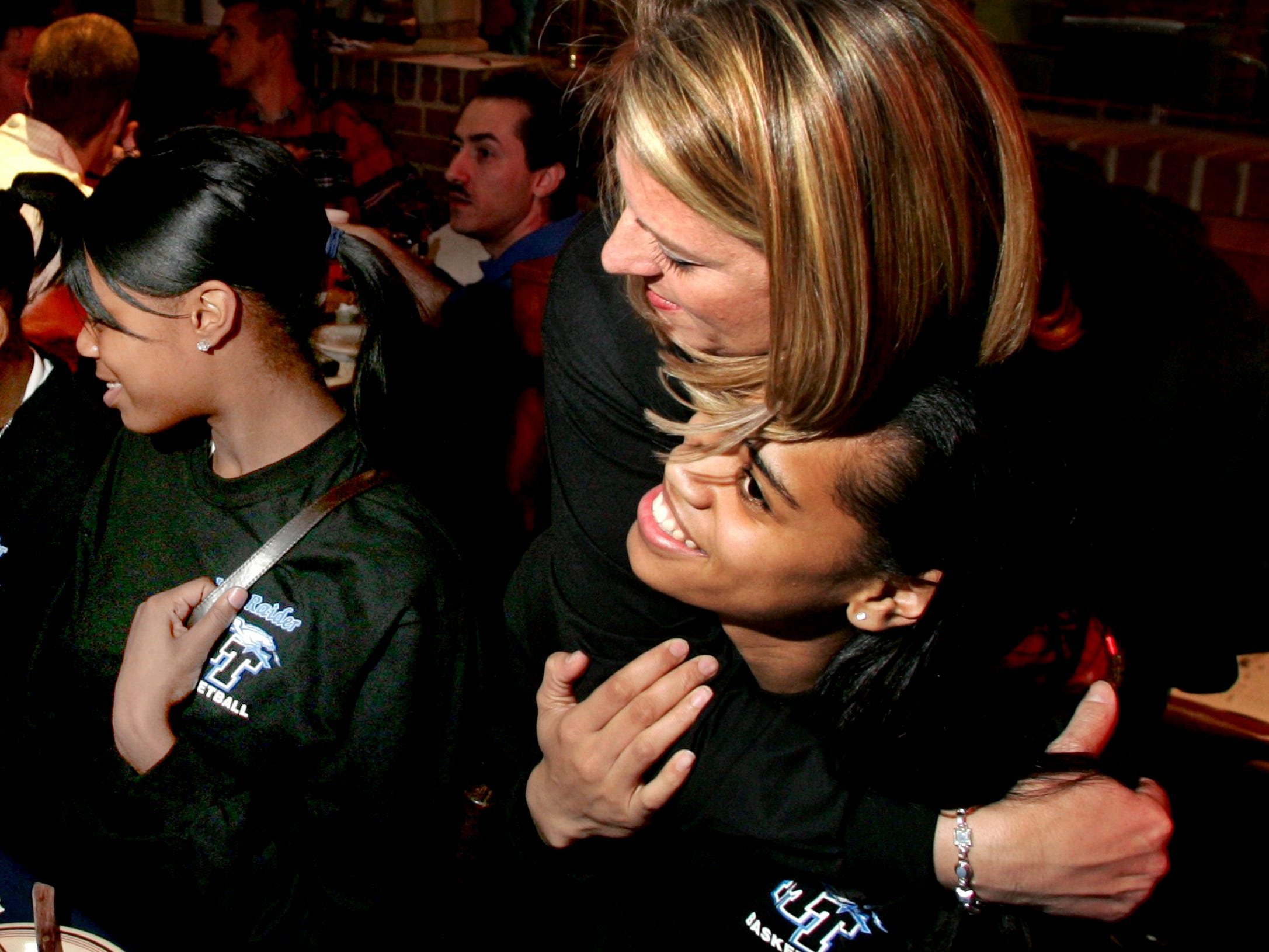 MTSU Coach Stephany Smith hugs her player Tia Stovall while watching the NCAA Basketball selection announcing that MTSU will play fifth-seeded North Carolina State (#22) on Saturday at Corky's BBQ restaurant in Murfreesboro, Tenn., Sunday, March 13, 2005.