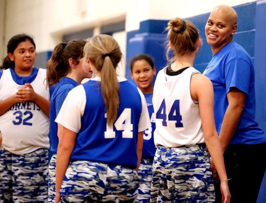 Huntland middle school girls basketball coach Tia Stovall talks with her players during a break in practice on Tuesday, Nov. 13, 2018. According to Stovall one of the hardest things about battling cancer was having to tell her players.