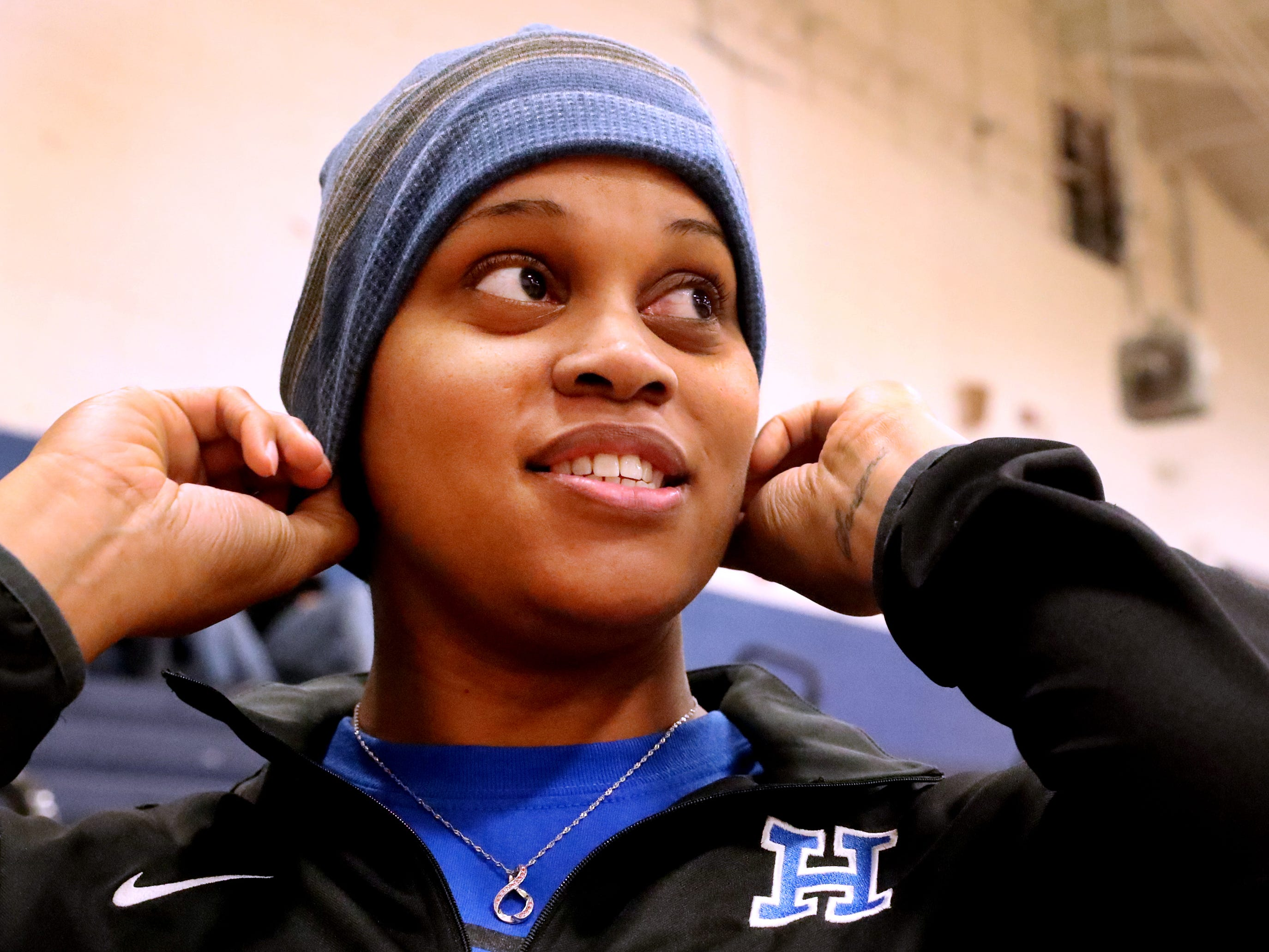 Huntland middle school basketball coach Tia Stovall puts on knit cap to cover her bald head before braving the cold after practice on Tuesday, Nov. 13, 2018. Stovall who is currently battling breast cancer said she sometimes where it in the gym as well because she gets cold easily due to the chemo.