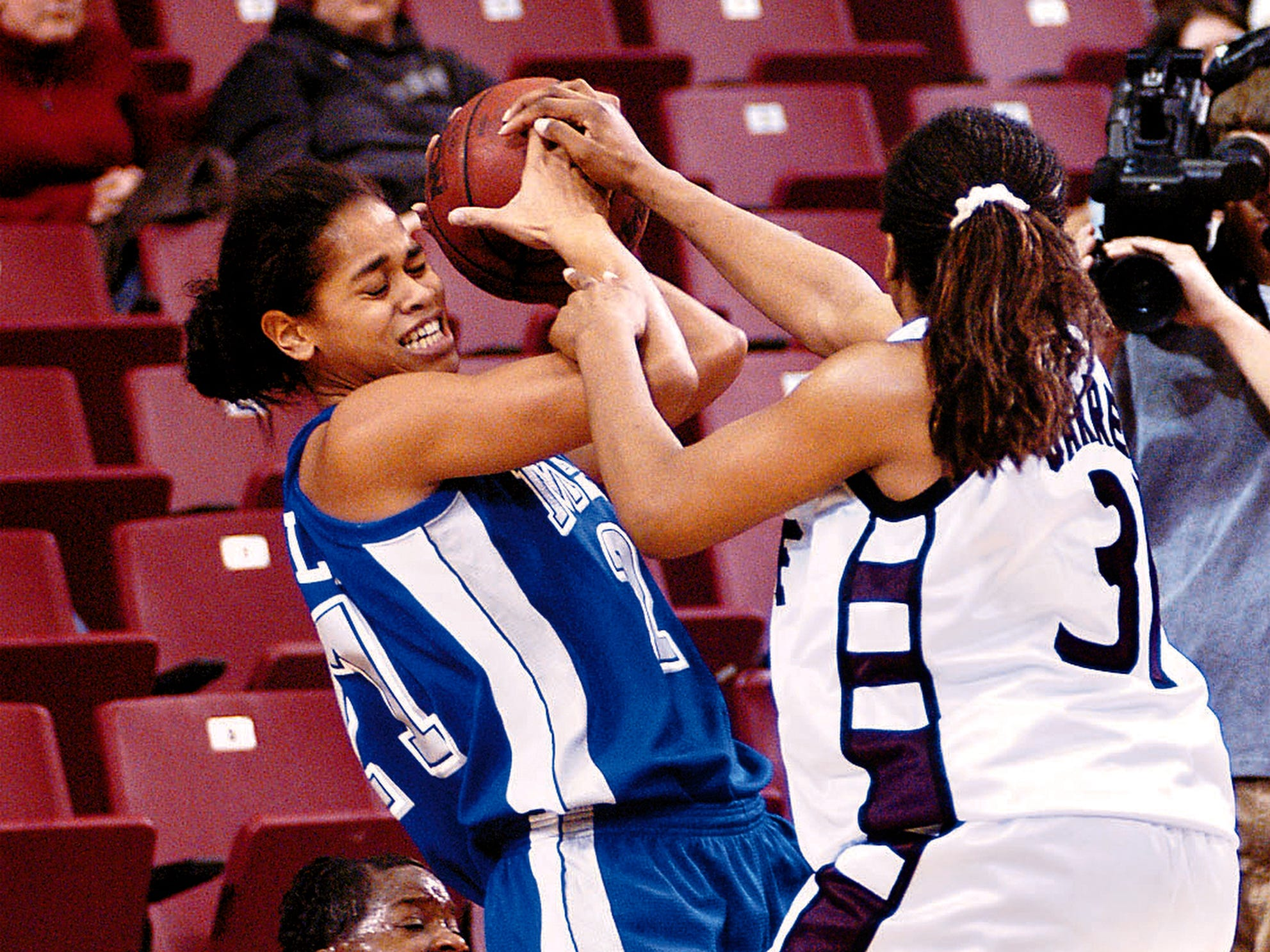MTSU' Tia Stovall fights for a ball during a game.