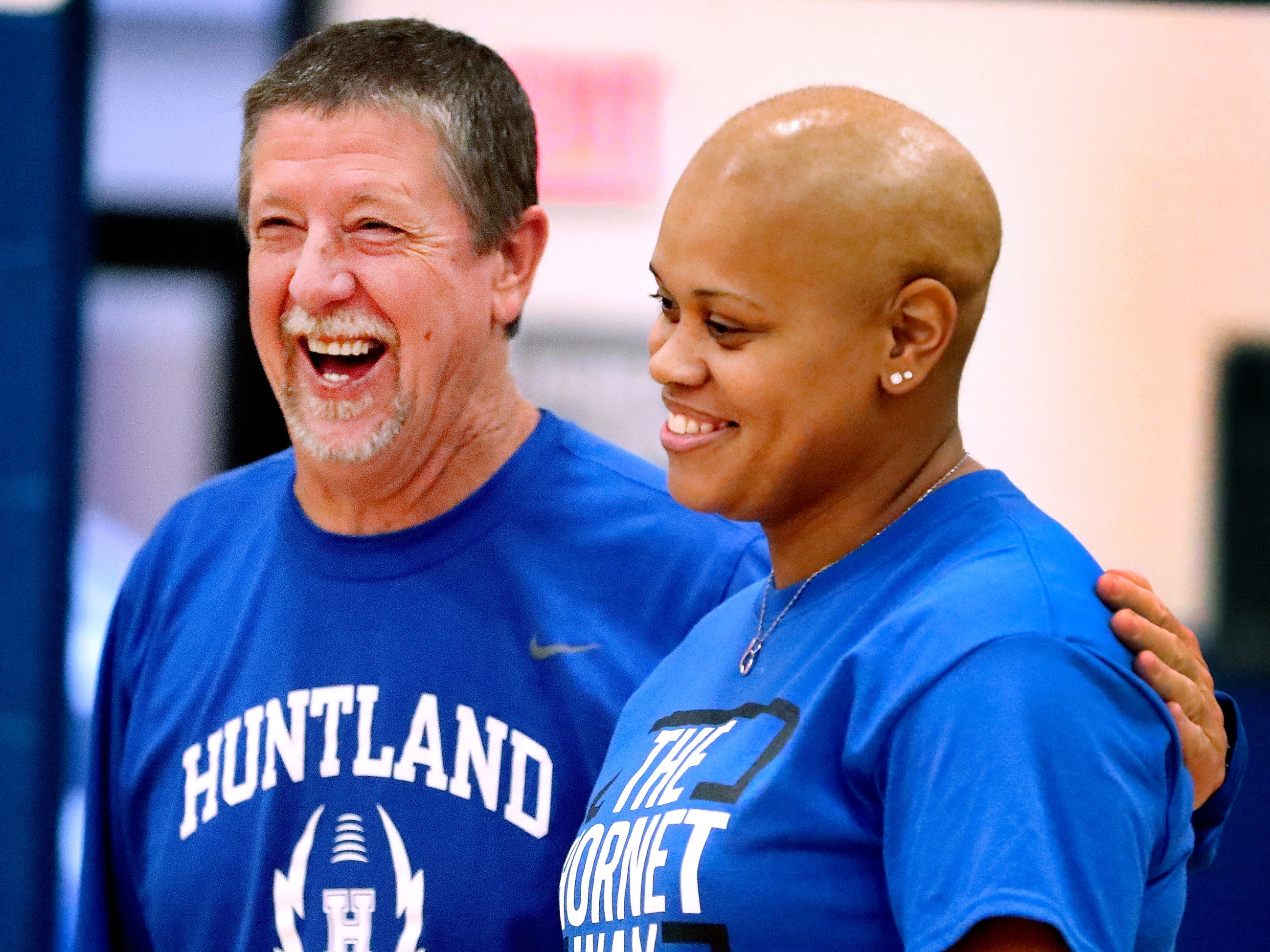 Bob Robertson the Athletic Director and Football Coach at Huntland School talks with Coach Tia Stovall, the girls middle school basketball coach, who has been battling breast cancer, during practice on Tuesday, Nov. 13, 2018.