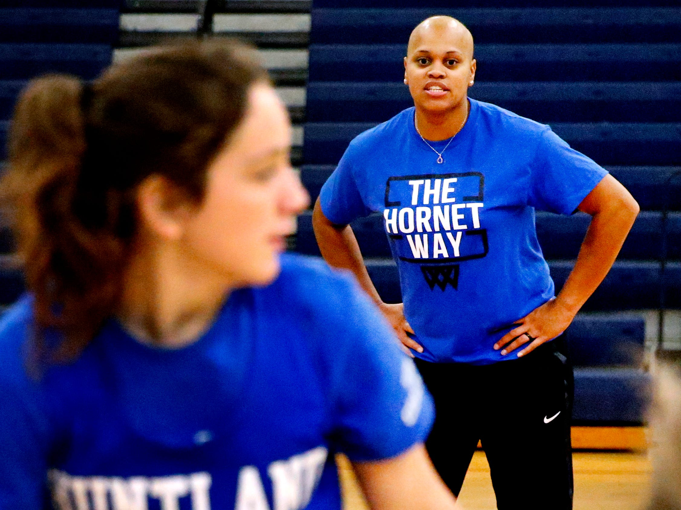 Coach Tia Stovall instructs Aubrie Suhr (24) and Morgan Sanders (14) during Huntland middle school girls basketball practice on Tuesday, Nov. 13, 2018, despite undergoing breast cancer treatment.