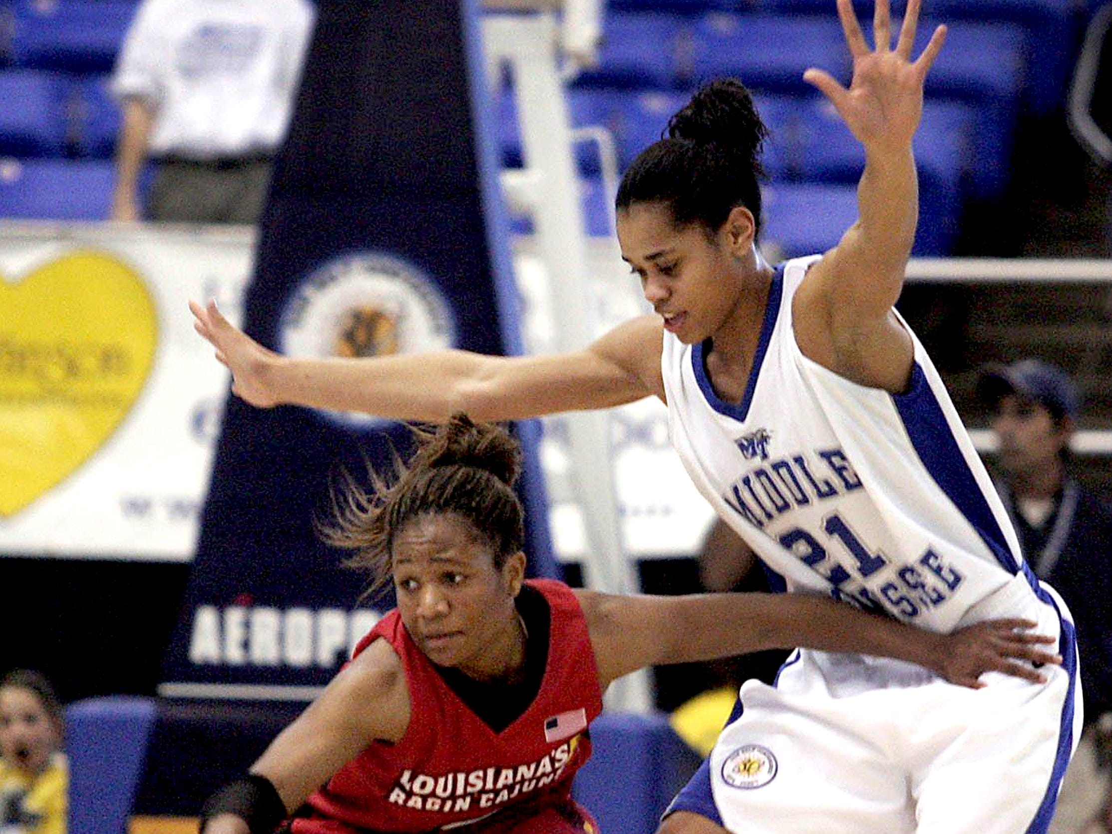 Louisianna-Lafayette's Ashley Blanche tries to fend off the defense of MTSU's Tia Stovall during the Lady Raiders' 84-58 win in the Quarterfinals of the 2006 Sun Belt Conference Tournament.