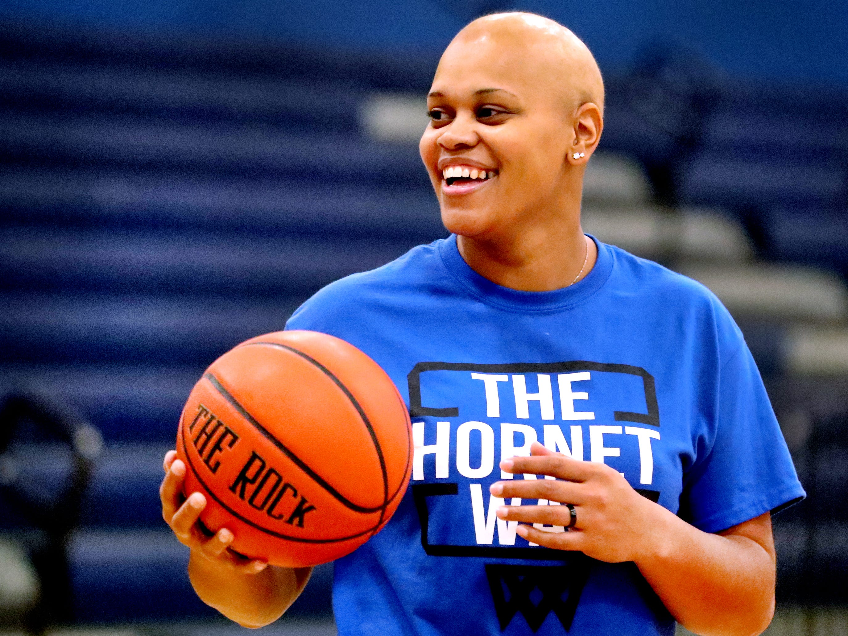"Huntland middle school girls basketball coach Tia Stovall and former MTSU basketball works with players during a practice despite currently battling breast cancer on Tuesday, Nov. 13, 2018. Stovall admits that some days are better than others, she said ""Today is a better day but I had a booster shot yesterday."""