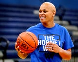 """""""With God and with basketball I try to come up with a game plan"""" is how Tia Stovall has elected to fight her breast cancer."""