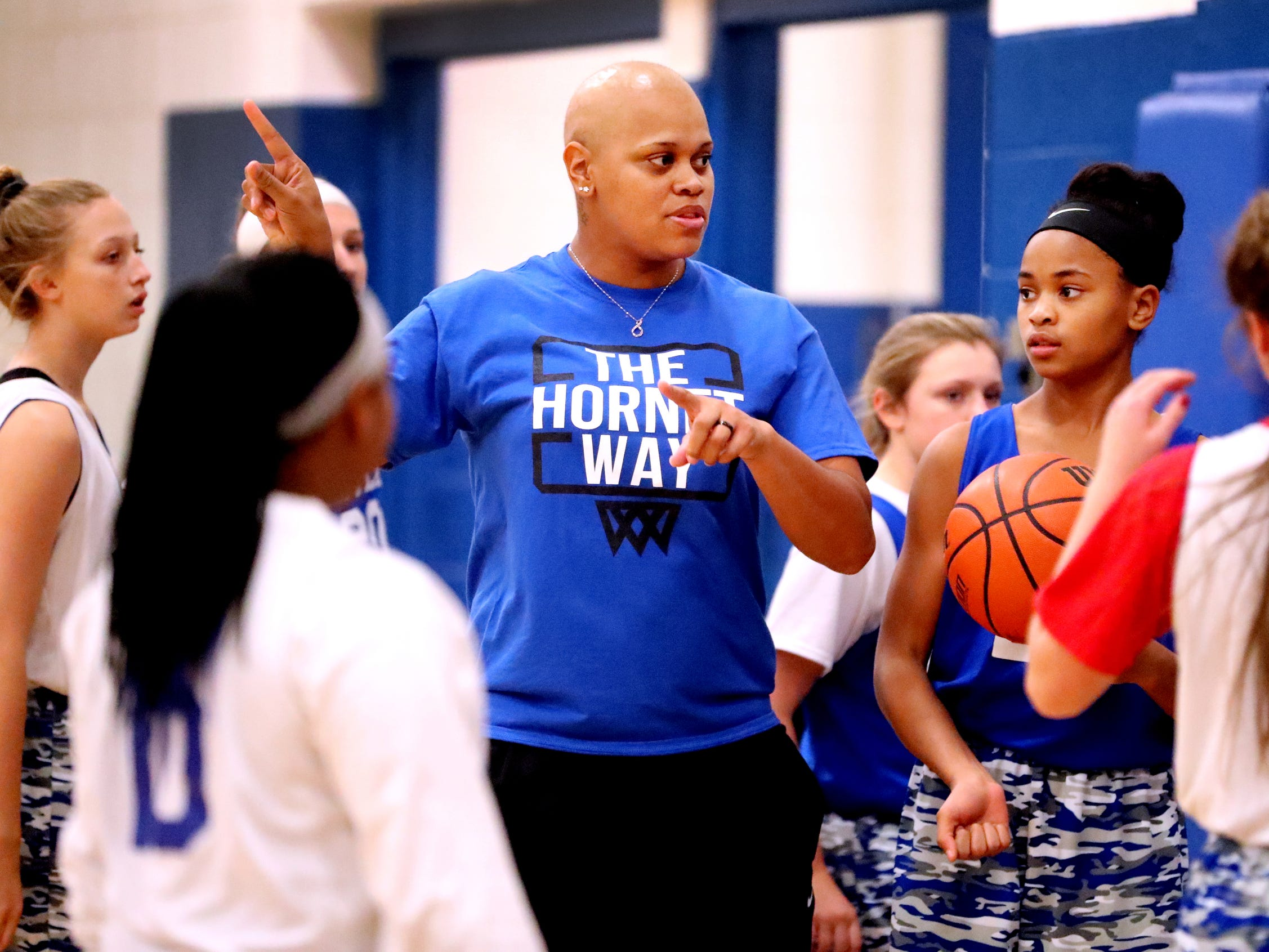 Huntland middle school girls basketball coach Tia Stovall instructs her team about their next drill during a huddle in practice on Tuesday, Nov. 13, 2018.