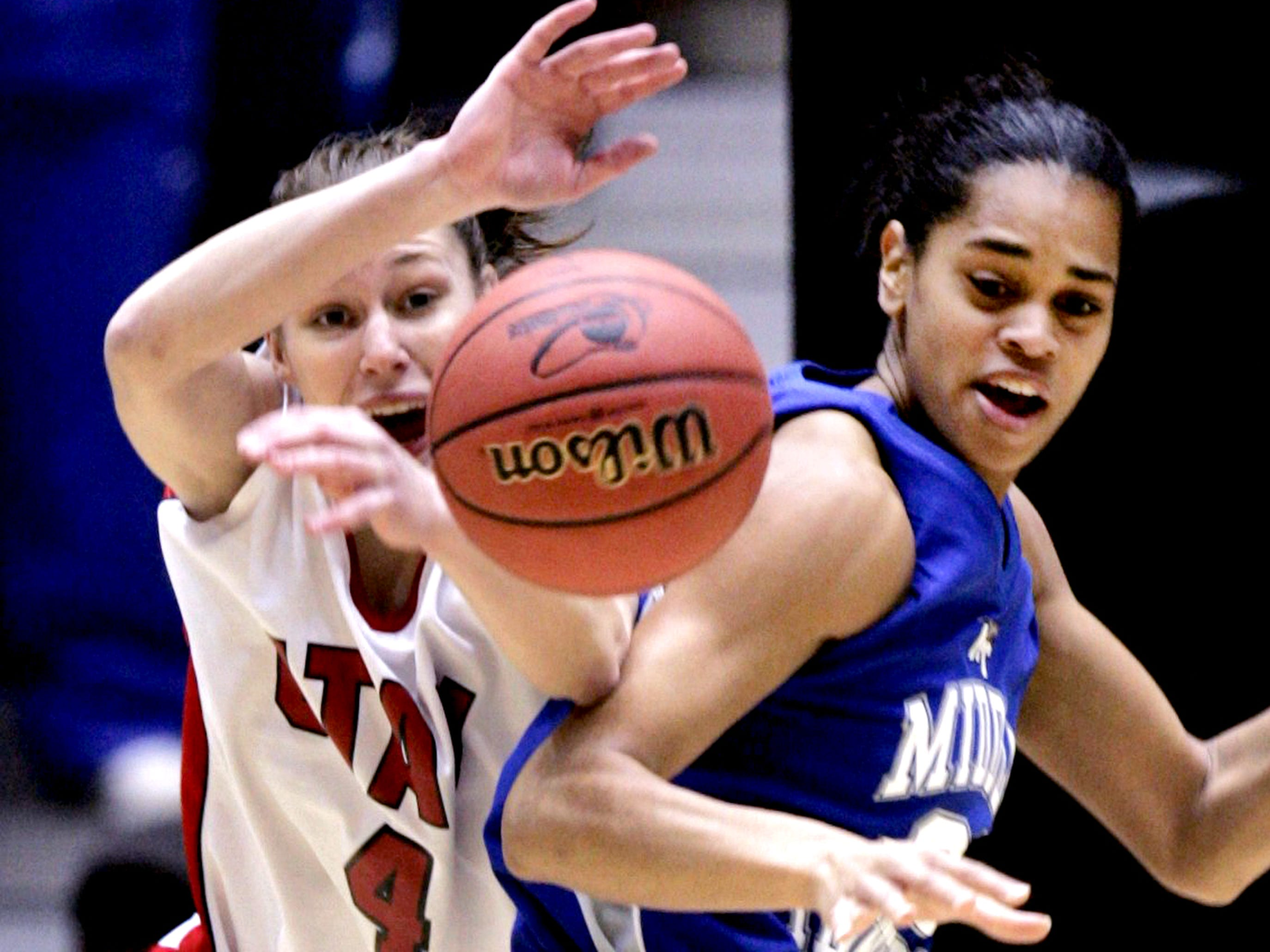 Utah's Kim Smith, left, battles Middle Tennessee's Tia Stovall for a loose ball during their first round NCAA Tournament basketball game in Tucson, Ariz., Saturday, March 18, 2006.