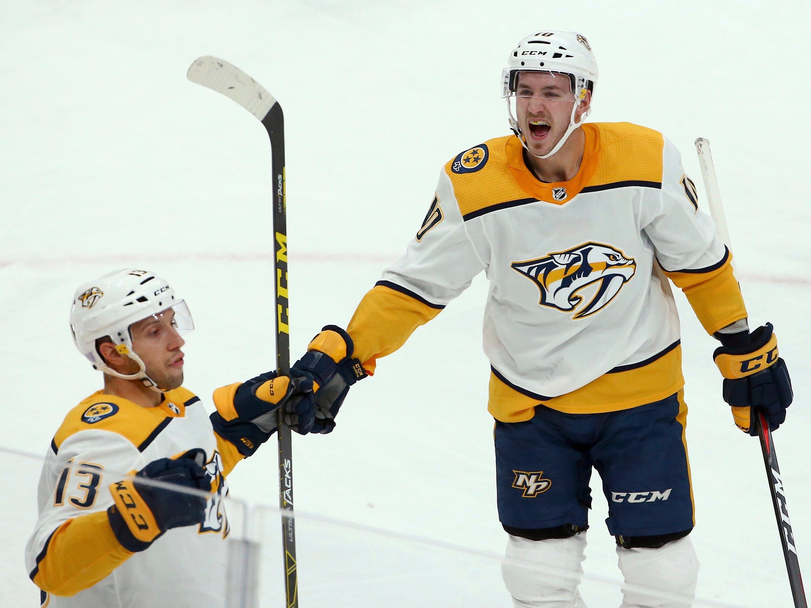 Nashville Predators center Nick Bonino (13) celebrates his goal against the Arizona Coyotes with Predators center Colton Sissons, right, during the third period of an NHL hockey game Thursday, Nov. 15, 2018, in Glendale, Ariz. The Coyotes defeated the Predators 2-1.