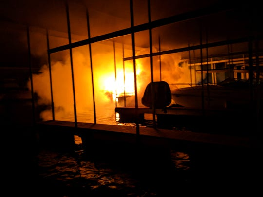 A fire damaged three boats and a dock at Drakes Creek Marina in Hendersonville on Nov. 16.