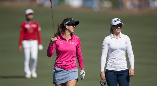 Emma Tally, left, and Jodi Ewart Shadoff walk up the ninth green during the CME Group Tour Championship at Tiburón Golf Club at the Ritz-Carlton Golf Resort in Naples on Friday.