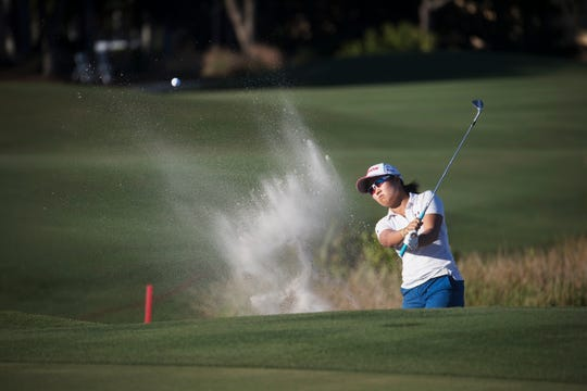 Nasa Hataoka hits out of a bunker on the 18th hole during the second round of the CME Group Tour Championship on Friday at Tiburón Golf Club at the Ritz Carlton Golf Resort.