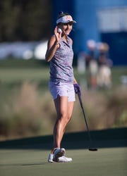 Lexi Thompson acknowledges the crowd on the 18th hole during the second round of the CME Group Tour Championship on Friday at Tiburón Golf Club at the Ritz Carlton Golf Resort in Naples. Thompson is leading the tournament at 12 under.