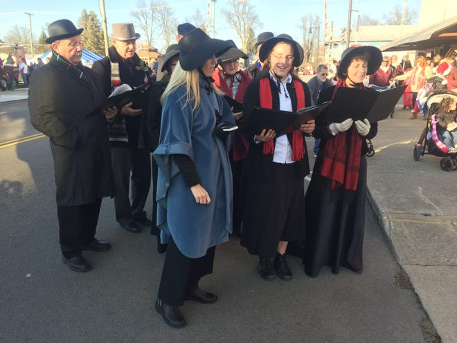 Strolling carolers entertain the crowd with holiday favorites during a past Pataskala Cookie Walk.