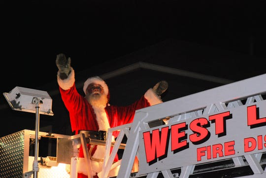 Santa Claus arrives by fire truck during a past Pataskala Christmas parade.