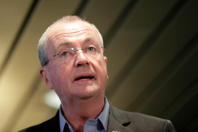 New Jersey Gov. Phil Murphy speaks during a news conference addressing a snowstorm that hit the northern New Jersey region a day earlier, Friday, Nov. 16, 2018, in Woodbridge, N.J. Murphy is under fire because many commuters were stranded on highways during the snowstorm that hit during the rush hour traffic.