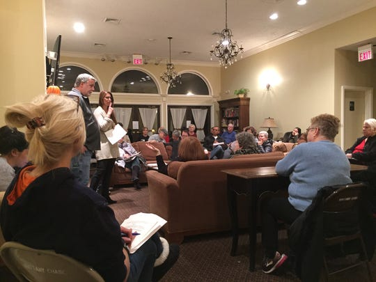 Members of a grass-roots group, called 'Wake up, Brittany Chase,' meet inside of the condo association's clubhouse to discuss its campaign strategy for the upcoming condo board election on Nov. 14.