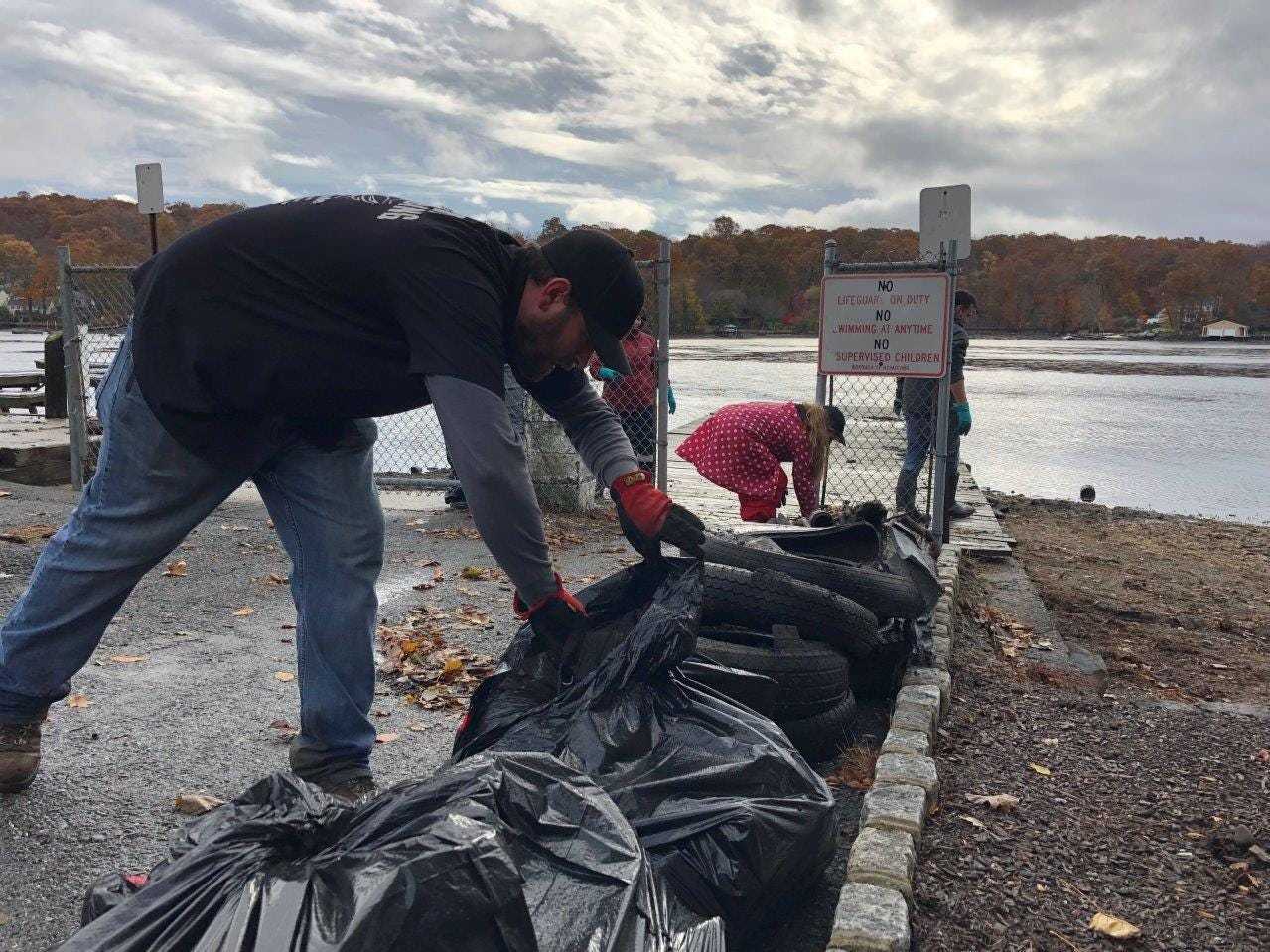 Bags and debris pile up during the Lake Hopatcong cleanup on Nov. 3, 2018.
