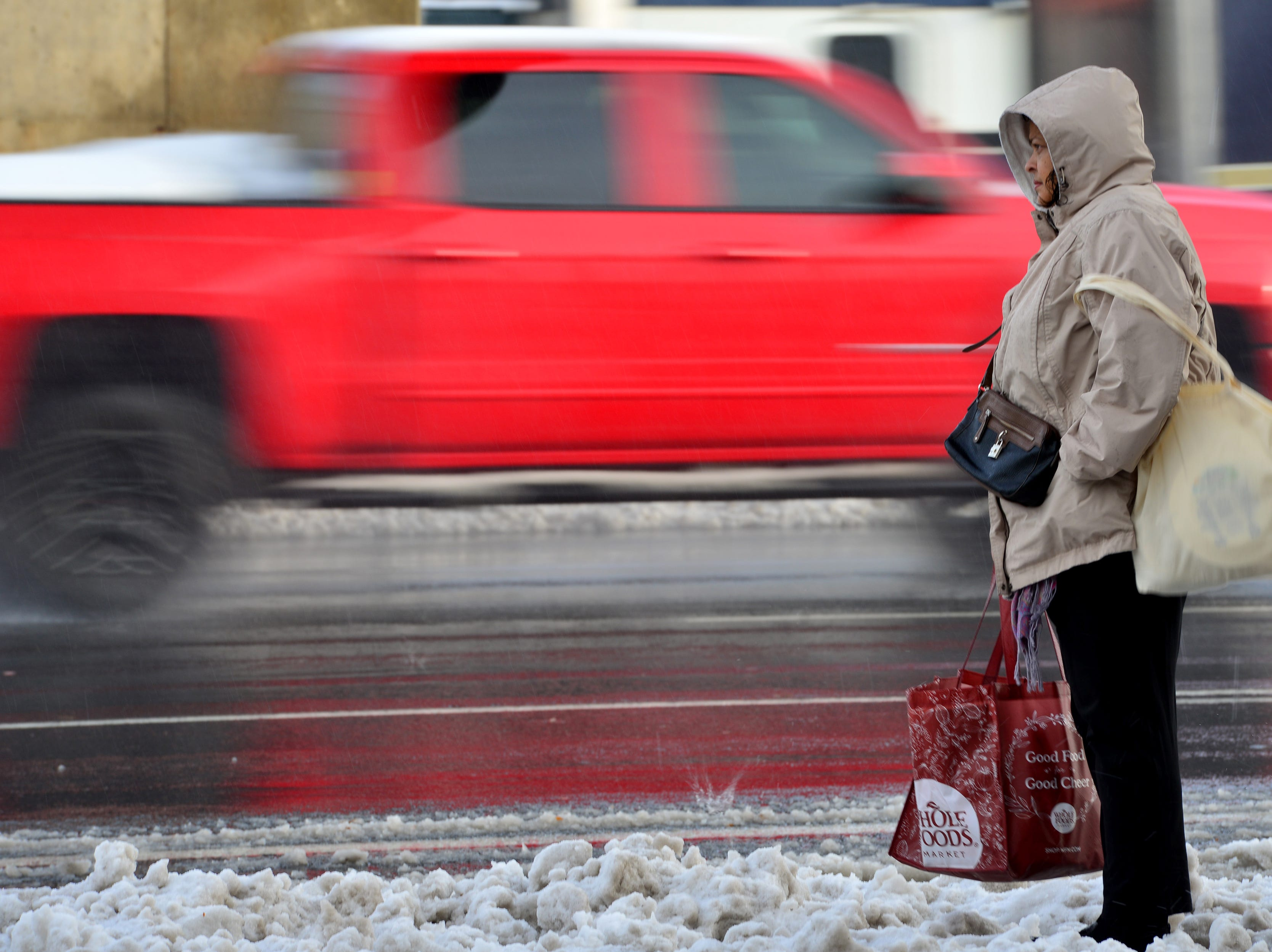 A woman waits for a bus along Route 4 eastbound in Paramus on Friday morning November 16, 2018.